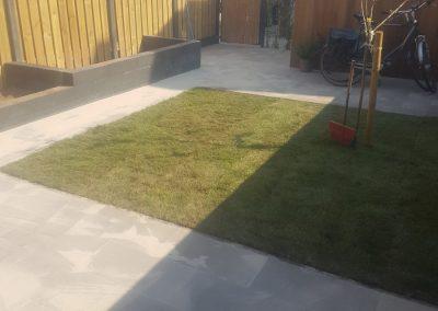 Tuinaanleg onderhoudsarme nieuwbouw tuin Amersfoort bestrating